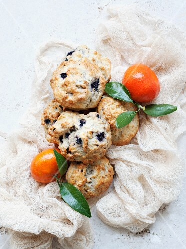 Blueberry scones with mandarins on a muslin cloth
