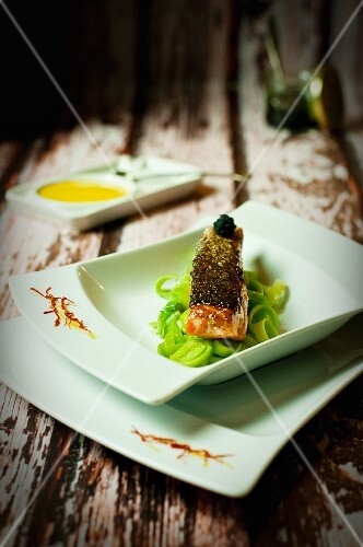 Salmon on a leek medley with caviar and saffron sauce