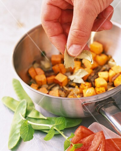 Curry leaves being added to a stuffing