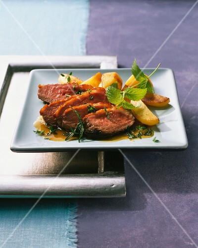 Duck breast with potato wedges and herbs