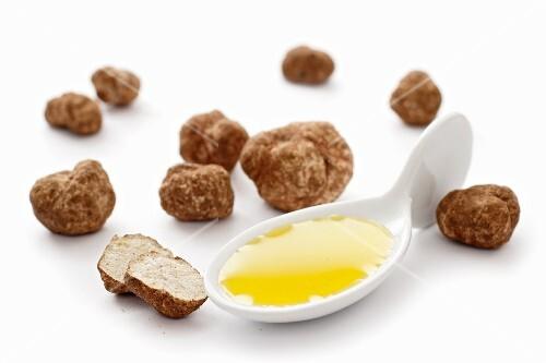 Sprue of truffle oil and fresh truffles