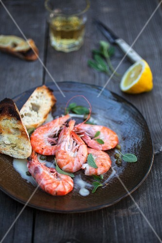 Poached prawns with capers, sweet aioli and grilled bread