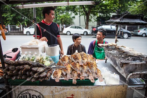 A fast food stand with grilled fish (Asia)
