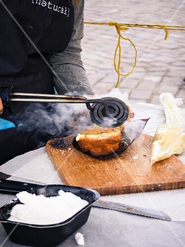 Street food being made – a cupcake being filled with Catalan creme (Barcelona)