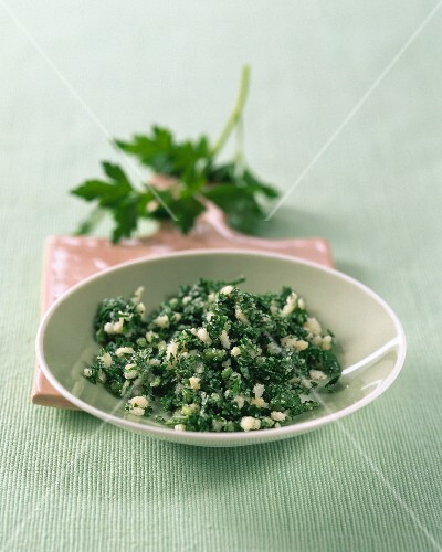 Coarse salt with parsley on a small plate
