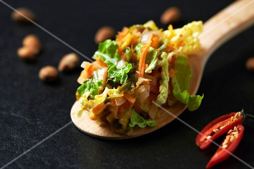 ingredients for Chinese and carrot stew on a wooden spoon (Paleo diet)