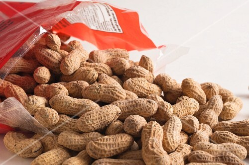 Peanuts spilling out of a bag