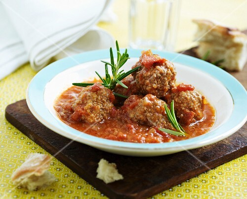 Lamb meatballs in tomato sauce with rosemary