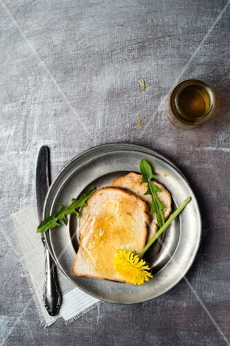A slice of toast spread with dandelion honey