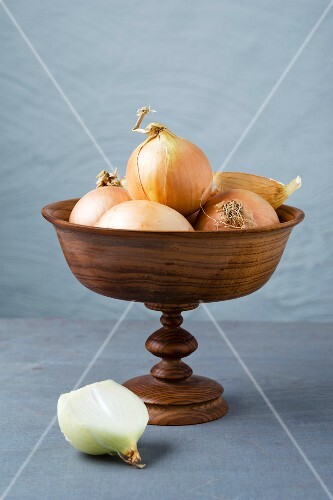 Onions in a wooden dish