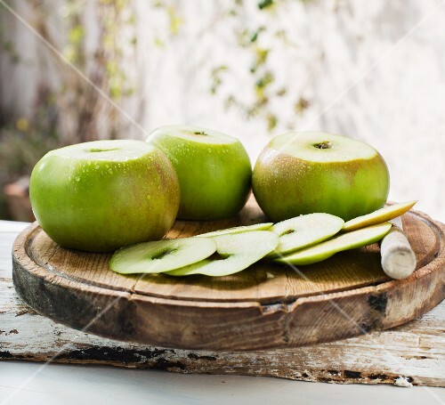 Bramley apples on a wooden board