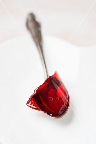 Red jelly on a spoon