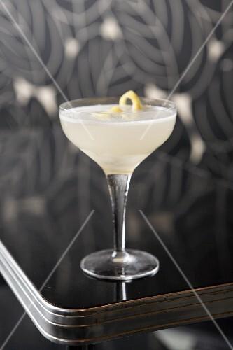Lemon Drop Cocktail with lemon zest on an Art Deco style table