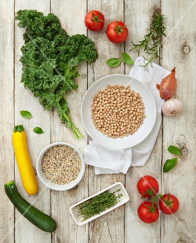 Ingredients for vegan minestrone: kale, quinoa, tomatoes, courgette and chickpeas