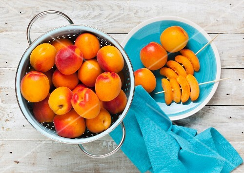 Freshly picked apricots with skewers