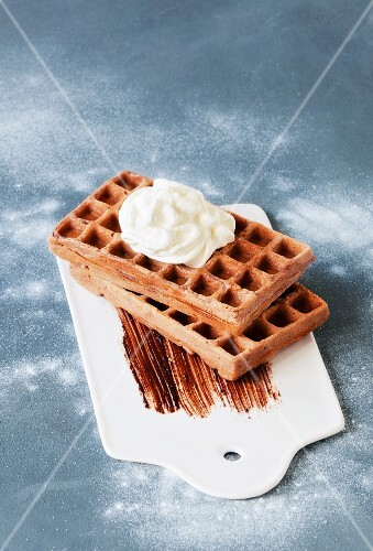 Chocolate waffles with a dollop of cream