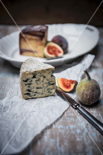 Fourme D'Ambert (French blue cheese) and wine hard cheese from Italy with figs