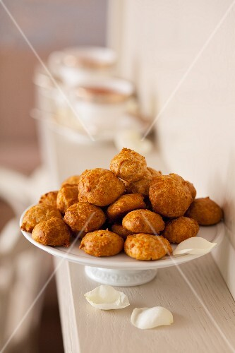 Cheesy bites on a white cake stand