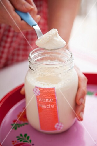 A spoon of homemade yoghurt