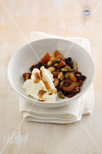 Hangop (buttermilk dessert, Netherlands) with dried fruit and seeds
