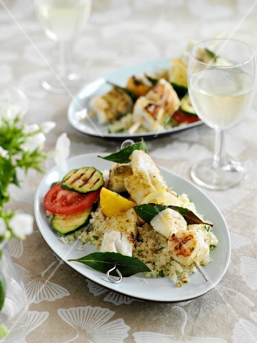 Fish skewers on couscous