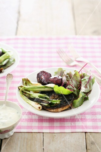 Roasted portobello mushrooms with spring onions and beetroot
