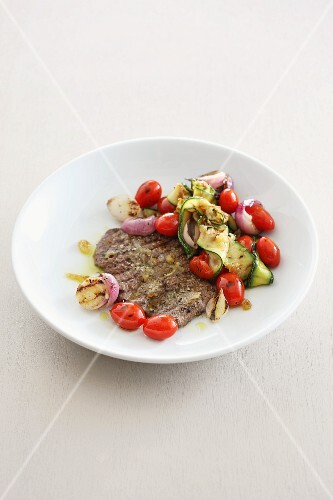 Organic steak with a tomato and cucumber salad