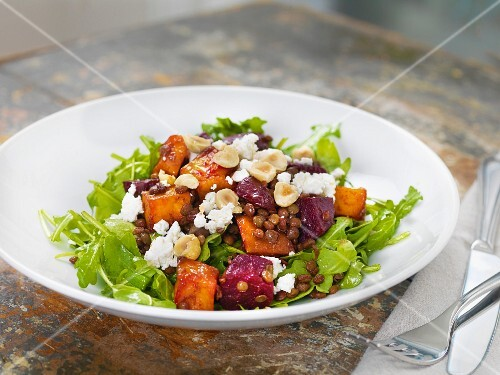 Lentil salad with rocket, beetroot, sweet potatoes, feta cheese and hazelnuts