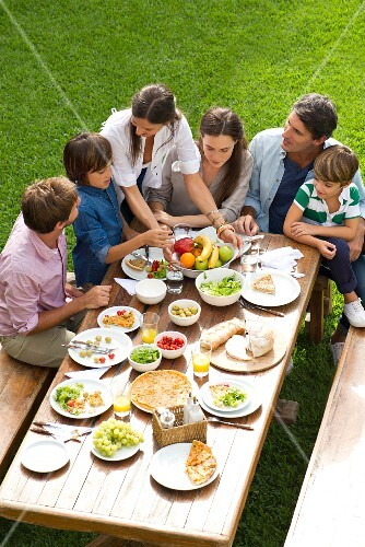 A family eating lunch in a garden