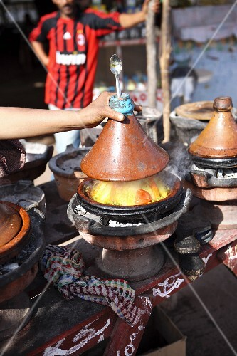 Food being cooked in a tagine, Morocco