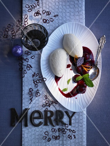 White honey and chocolate mousse with mulled wine cherries for Christmas