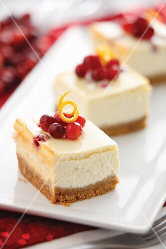 Slices of cheesecake with cranberries