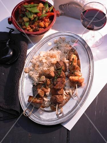 Moorish skewers on almond rice