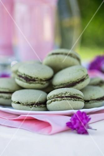 Green macaroons with matcha tea and chocolate ganache