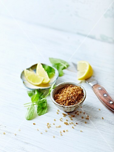 Brown sugar, lemon wedges and mint leaves