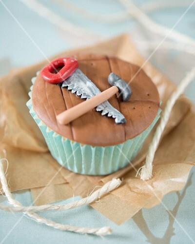 A carpentry themed cupcake
