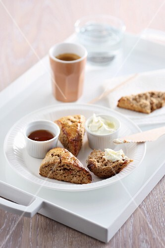 Wholemeal scones with clotted cream and honey