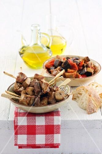 Pork skewers with Mediterranean vegetables
