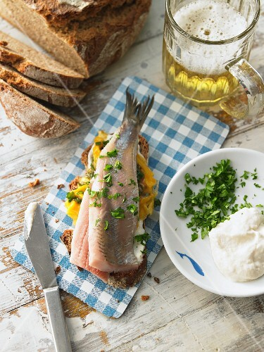 A slice of bread topped with egg, soused herring and horseradish (Northern Germany)