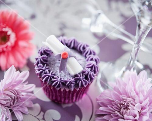 A purple graduation cupcake