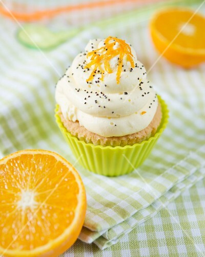 An orange and poppy seed cupcake