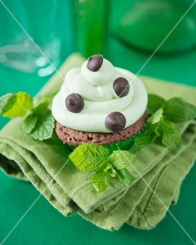 A mint chocolate chip cupcake