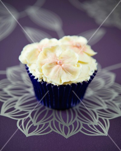 A white chocolate pansy cupcake