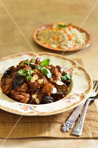 Lamb tagine with plums and couscous