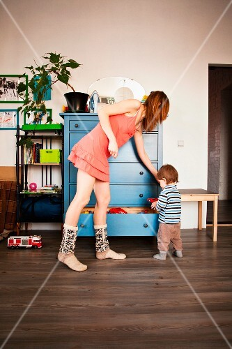 A mother and her young son in a playroom