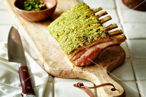 Rack of Lamb with Herb Crust on Cutting Board; Sliced
