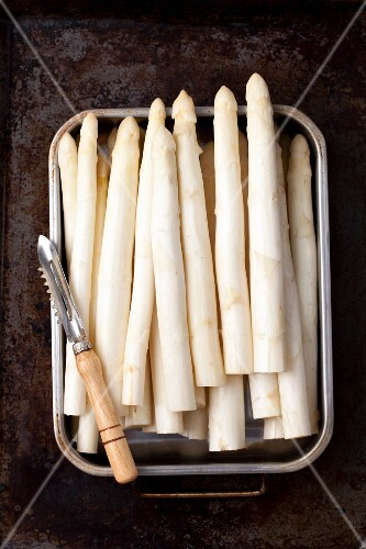 White asparagus with a peeler