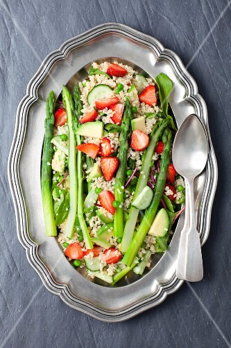 Bulgur and asparagus salad with strawberries, peas and young beetroot leaves