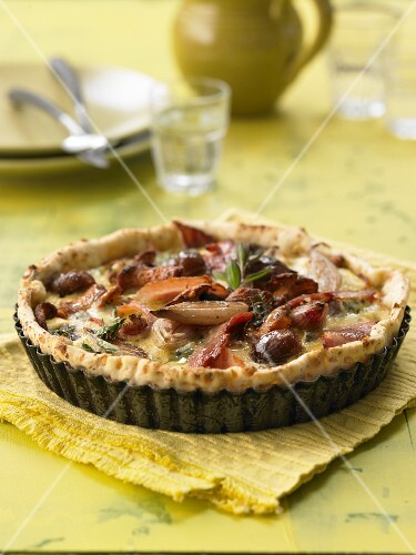 An autumnal tart with chestnuts, onions and bacon