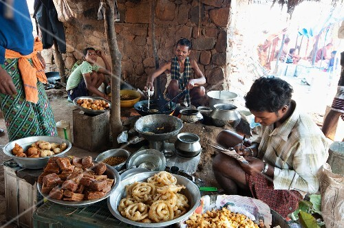 Jelabi and other sweets being made at a weekly market, Guneipada, Koraput district, Orissa, India